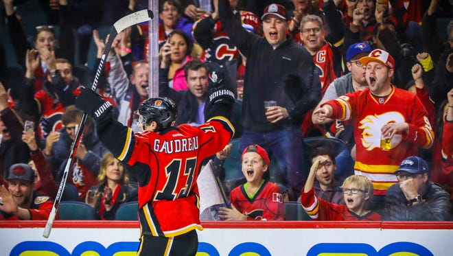 Flames forward Johnny Gaudreau (13) celebrates his goal during the first period.