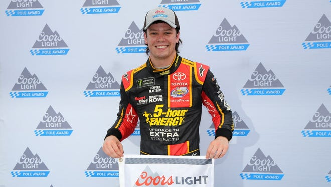 Erik Jones poses with the Coors Light Pole Award after qualifying for the Monster Energy NASCAR Cup Series race at Bristol Motor Speedway.
