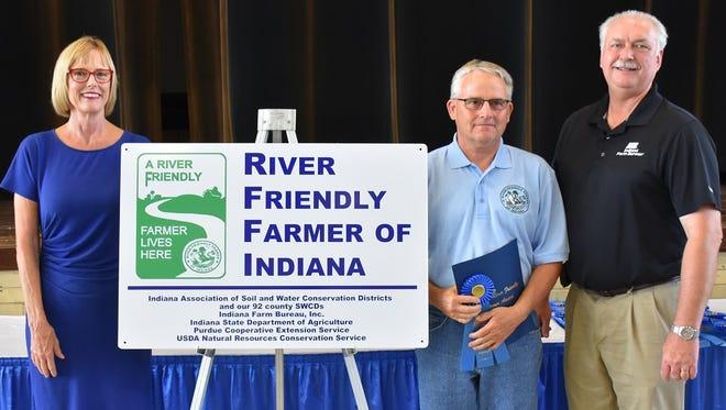 Delaware County farmer Larry Shreve (center) receives a River Friendly Farmer award from Lt. Gov. Suzanne Crouch (left) and Indiana Farm Bureau President Randy Kron.