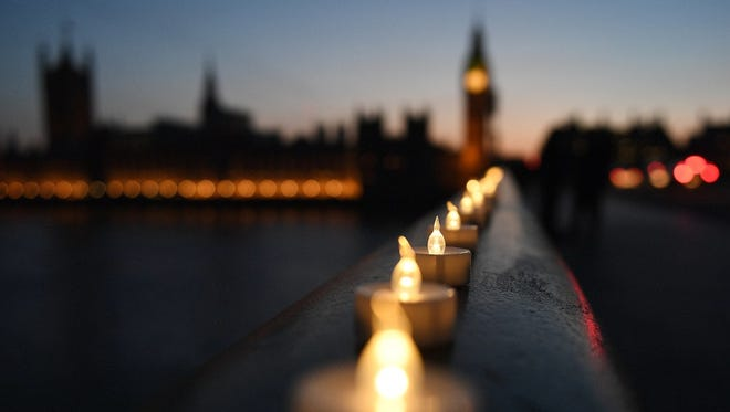 Plastic candles lie along Westminster Bridge in London, site of a terrorist attack in March.