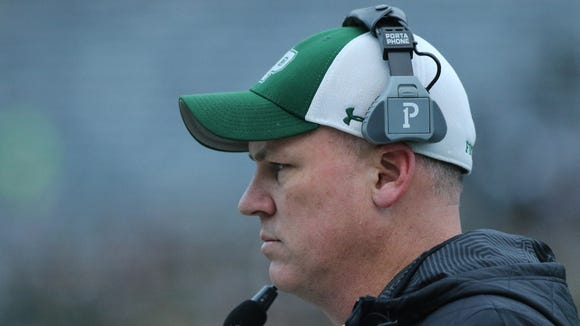 DePaul head coach John McKenna and the Spartans beat