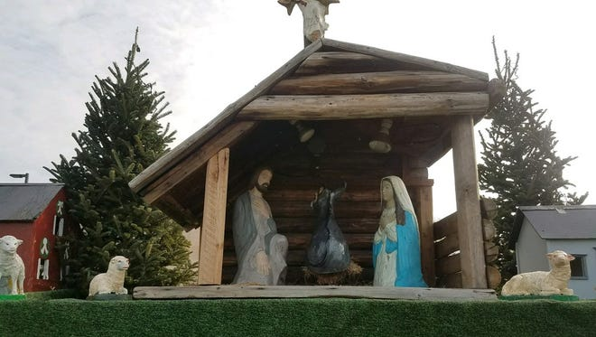 A baby Jesus figure taken from a nativity scene at St. Patrick's Catholic Church earlier this week