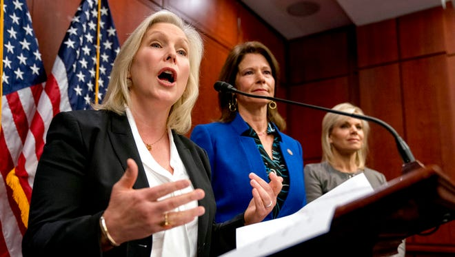 From left, Sen. Kirsten Gillibrand, D-N.Y., accompanied by Rep. Cheri Bustos, D-Ill., and former Fox News host Gretchen Carlson, speaks at a news conference where she and other members of congress introduce legislation to curb sexual harassment in the workplace, on Capitol Hill, Wednesday, Dec. 6, 2017, in Washington. Gillibrand and fellow female Democratic senators have united in calling for Sen. Al Franken to resign amid sexual misconduct allegations. (AP Photo/Andrew Harnik)