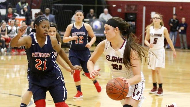 Morgan Gentile of Elmira drives toward the basket as Kaziah Ross of Binghamton defends Feb. 8 at Elmira High School.