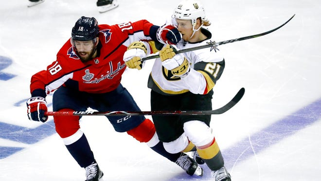 Washington Capitals forward Chandler Stephenson (18) contends with Vegas Golden Knights forward Cody Eakin (21) during the third period in Game 3 of the NHL hockey Stanley Cup Final, Saturday, June 2, 2018, in Washington.