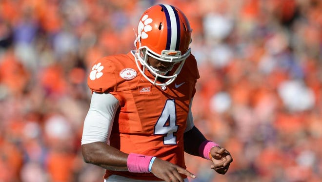 Clemson quarterback Deshaun Watson (4) leaves the game with an injured right index finger during the 1st quarter Saturday, October 11, 2014 at Clemson's Memorial Stadium. Watson did not return to the game.