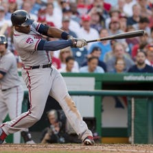 Sep 10, 2014; Washington, DC, USA; Atlanta Braves left fielder Justin Upton (8) hits a two-run double during the seventh inning against the Washington Nationals at Nationals Park.  The Braves won 6-2. Mandatory Credit: Tommy Gilligan-USA TODAY Sports
