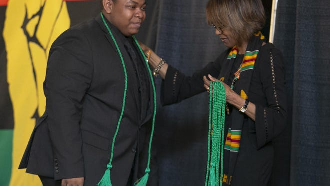 Rock Valley College professor Theresa Gilbert congratulates David Daye on Sunday, May 19, 2019, at the All Black High School Graduation at Riverview Inn & Suites in Rockford. A second annual All Black High School Graduation will be held this Sunday.