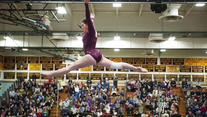 CVU's Jam Giubardo competes in the beam during the Vermont state high school gymnastics championship at Essex high school on Saturday afternoon in Essex.