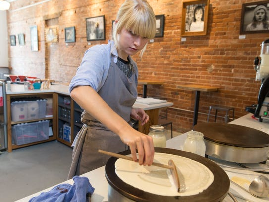 Gretchen Grant spreads a crepe at Beau Basin in Carencro