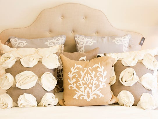 Accent pillows on a bedroom set at ReMix Marketplace