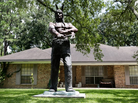 Charlie DeVille's American Indian statue in front of