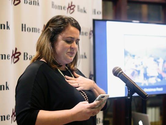 Flood victim advocate Whitney Andrus speaks during