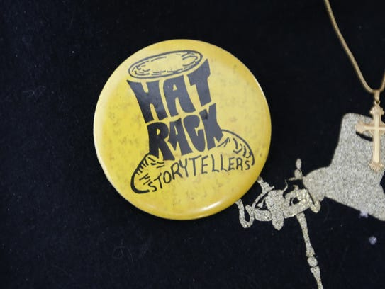 A pin for the Hatrack Storytellers, which was started