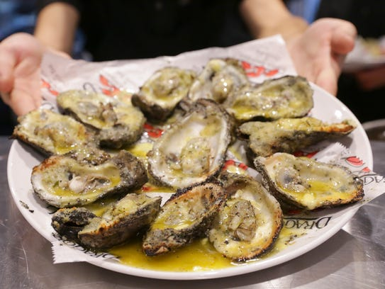 Charbroiled oysters at the soft opening of Drago's