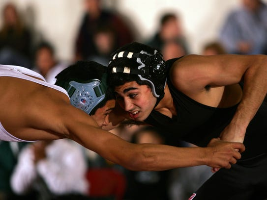 Vinnie DelleFave of Toms River East, right, locks up