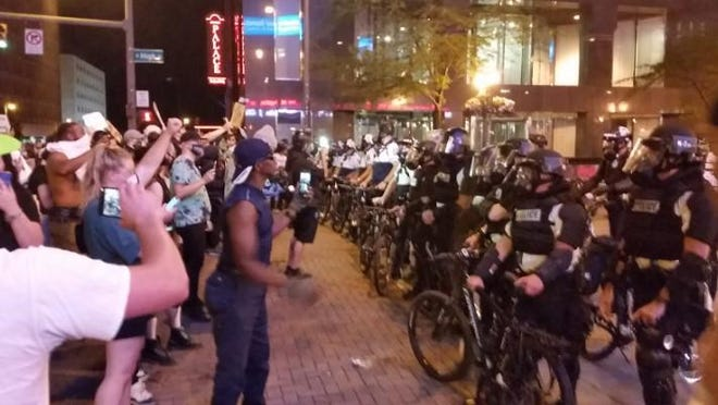 Protesters at Broad and High streets in downtown Columbus on Thursday night, May 28, calling attention to the death of George Floyd, a 46-year-old black man in Minneapolis.