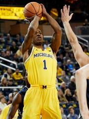 Michigan guard Charles Matthews (1) shoots in the first half on Saturday, Nov. 11, 2017, at Crisler Center.