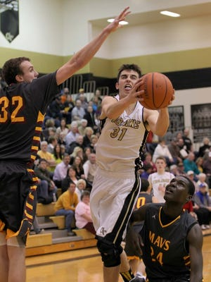 Jordan Ahrens and the Covington Trojans are ranked fourth in the first AP boys basketball poll.