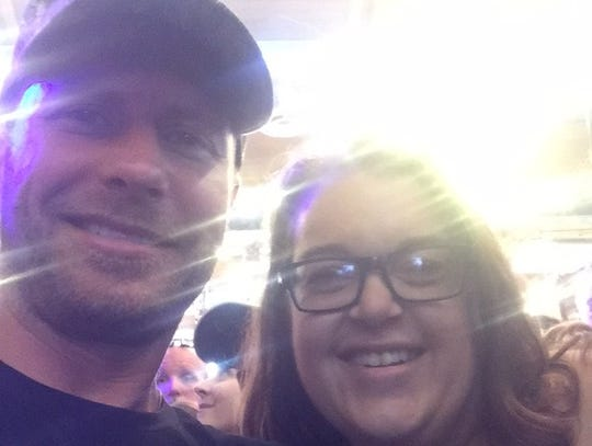 Natalie Tilque of Gilbert poses with Dierks Bentley