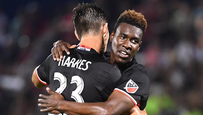 D.C. United midfielder Lloyd Sam (8) is congratulated by midfielder Ian Harkes (23) after scoring a goal against Christos FC  during the second half at the Maryland Soccerplex on June 13.
