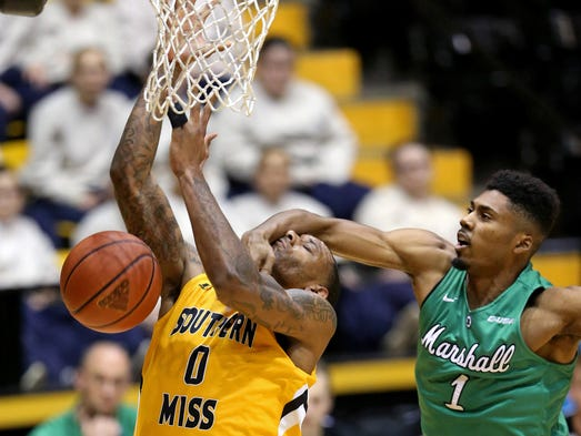 Southern Miss forward Raheem Watts is fouled by Marshall