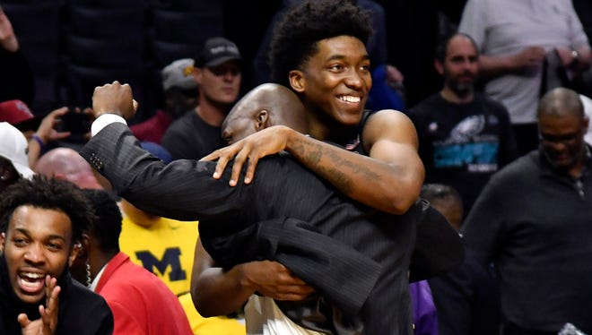 Mar 22, 2018; Los Angeles, CA, USA; Florida State Seminoles guard Terance Mann (14) and head coach Leonard Hamilton celebrate after defeating the Gonzaga Bulldogs in the semifinals of the West regional of the 2018 NCAA Tournament at STAPLES Center. Mandatory Credit: Robert Hanashiro-USA TODAY Sports