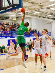 Novi's Traveon Maddox (2) had five dunks in a 74-56 district final win over Northville.