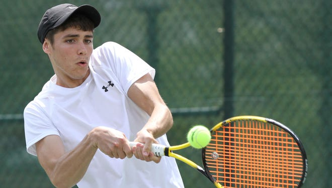 Ashland's Tim Sprunger competes in a singles game during the Ohio Cardinal Conference at the College of Wooster on Saturday.