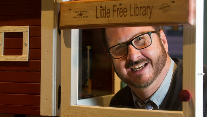 Little Free Library co-founder Todd Bol is shown with the first library he made in Hudson, Wisconsin. Bol died Thursday, Oct. 18, 2018. He was 62.
