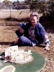 Koreshan Unity president Hedwig Michel with a model of the new headquarters in 1973. The building was finished in 1979.