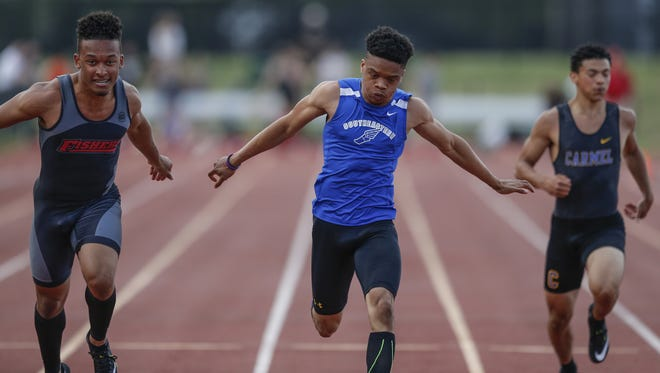 Hamilton Southeastern sprinter Noah Malone, center, wins the 100 meter dash with a time of 10.80 during the boys IHSAA track and field sectionals at Carmel High School on Thursday, May 17, 2018. Teams competing were Carmel, Fishers, Guerin Catholic, Hamilton Southeastern, Hamilton Heights, Lebanon, Noblesville, Sheridan, University, Western Boone and Westfield.