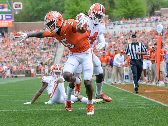 Clemson wide receiver Tee Higgins (5) catches a touchdown near safety Denzel Johnson (14) during the 1st quarter of the spring game in Memorial Stadium in Clemson on Saturday, April 14, 2018.