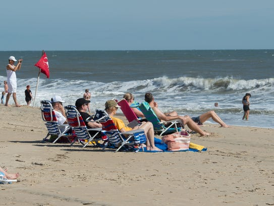 View of beach goers at Rehoboth Beach a day after Hurricane
