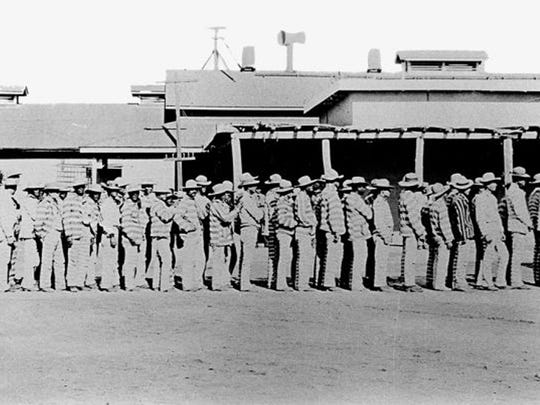 Inmates line up at the Yuma Territorial Prison, circa