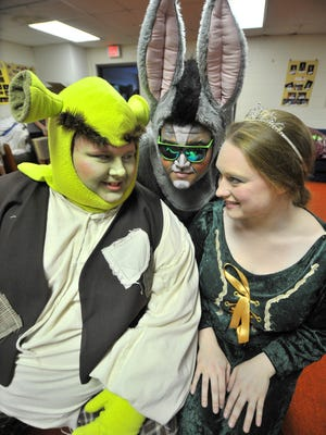 "Kate Kierzkowski, right, plays as Princess Fiona, Marcus Snow as Donkey and Spencer Loomis as Shrek, rehearse ""Shrek the Musical"" Tuesday at Wausau Community Theatre in Schofield."