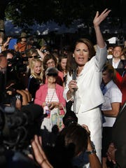 Rep. Michele Bachmann R-Minn., waves to the crowd after