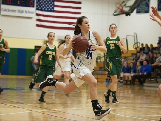 Colcheter's Gabby Gosselin (24) drives to the hoop during a high school girls basketball playoff game last season.