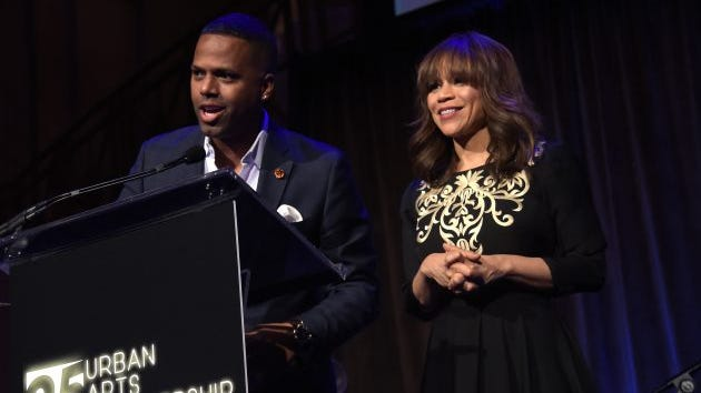 TV Personality A. J. Calloway and actress Rosie Perez speak on stage during the celebration of Urban Arts Partnership 25th Anniversary Benefit at Cipriani Wall Street on March 15, 2017 in New York City.