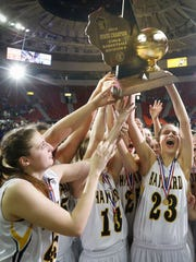 Hayward players raise their trophy after defeating Milwaukee School of Languages 43-31 in the WIAA Division 3 girls state basketball championship.