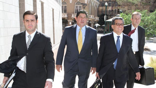 Former El Paso Independent School District Superintendent Lorenzo García, second from left, leaves the U.S. Courthouse after pleading guilty in 2012 to two counts of conspiracy to commit mail fraud.