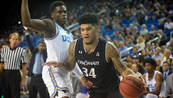 Cincinnati Bearcats guard Jarron Cumberland (34) moves the ball against UCLA Bruins guard Aaron Holiday (3) during the first half at Pauley Pavilion.