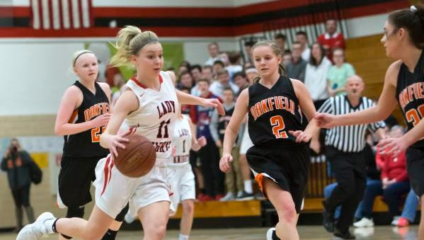 Lourdes Academy's Alexis Rolph weaves between Oakfield players Saturday during a WIAA Division 5 regional final game at Lourdes Academy.