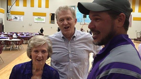 Mike McConathy and his mother, Corene McConathy, talk with Chris Romero during Tuesday's NSU event at BPCC.