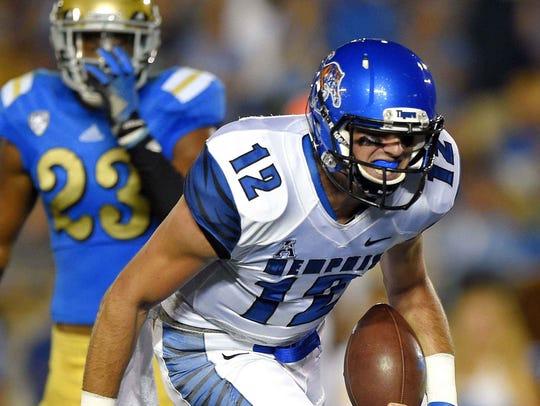 Memphis quarterback Paxton Lynch, right, runs the ball