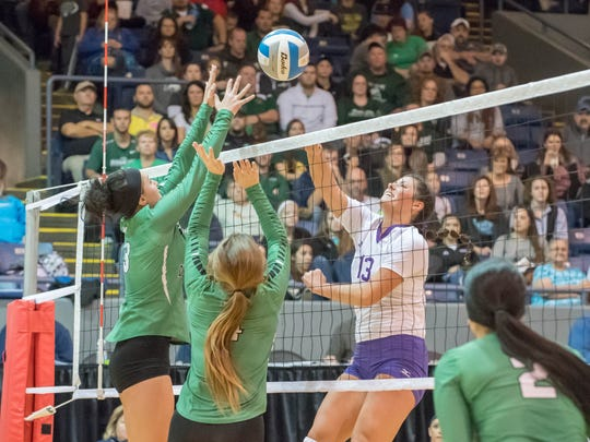 Bronson's Jill Pyles goes for the kill during the 2016 Class C State Volleyball Championship at Kellogg Arena on Nov. 19