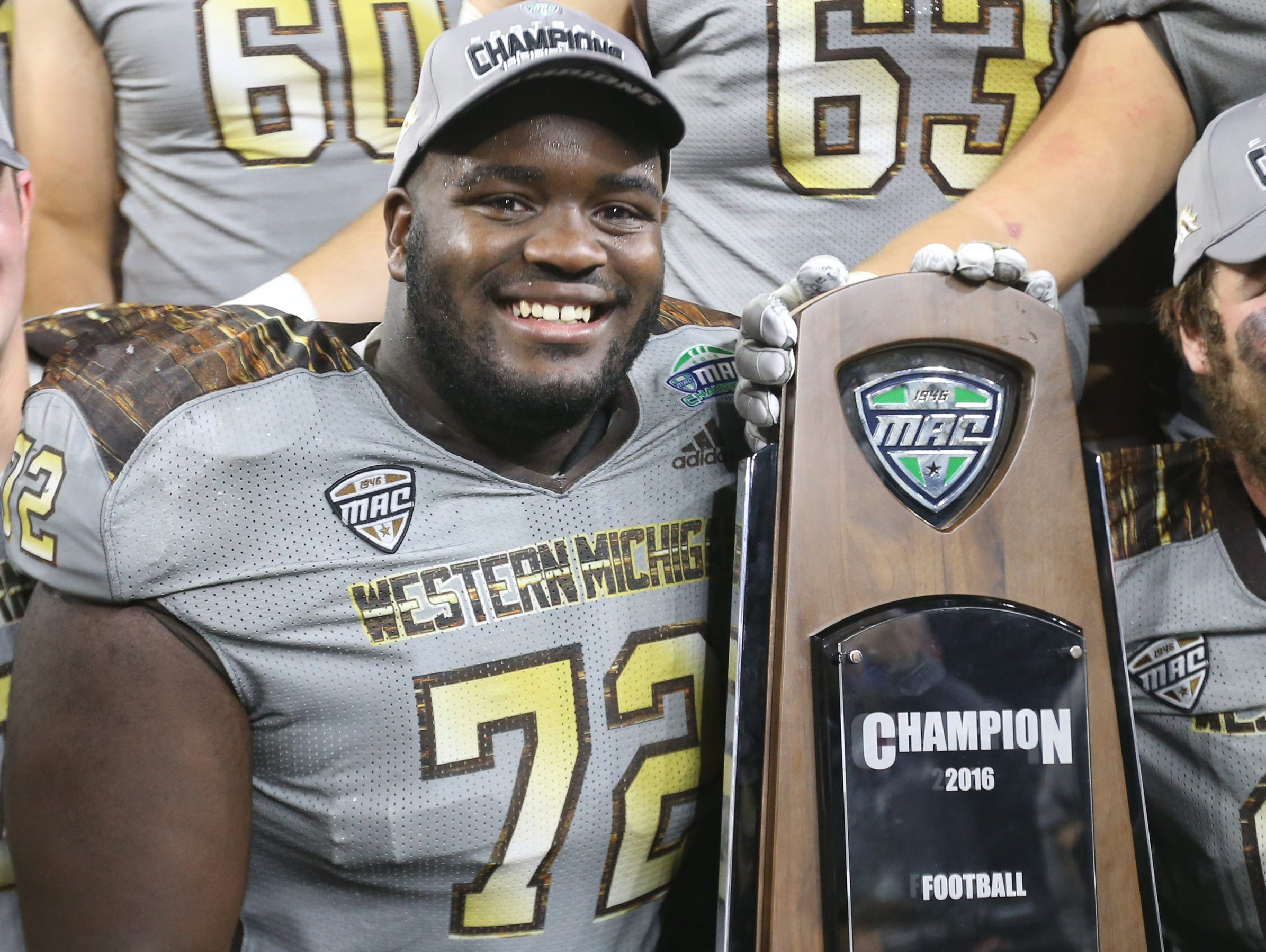 Western Michigan lineman Taylor Moton celebrates the 29-23 win over Ohio in the MAC Championship Friday, Dec. 2, 2016 at Ford Field in Detroi.