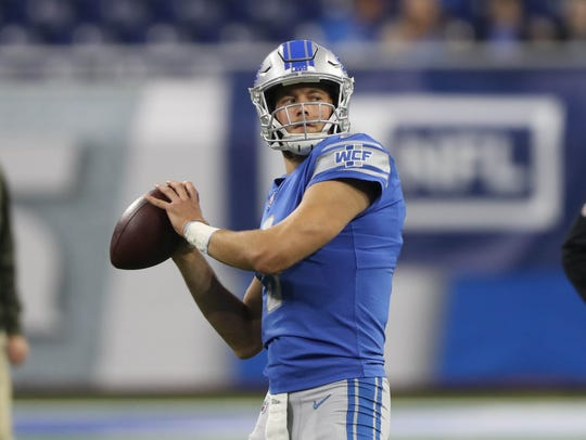 Detroit Lions QB Matthew Stafford warms up before action
