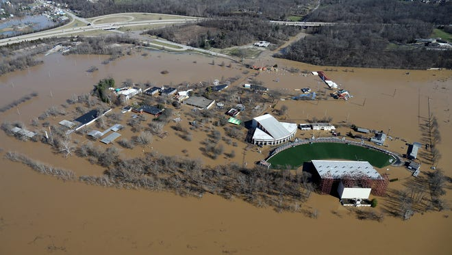 Aerial photograph of Coney Island and Riverbend Music Center as waters break the banks of the swollen Ohio River, Monday, Feb. 26, 2018. The river rose above the 60 feet mark for the first time in two decades Sunday morning, but the levee by nearby Lunken Airport held.