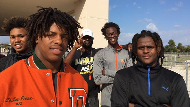Dunbar's relay team, left to right, of Lajuan Preston, Seneca Milledge, Jaderius McKnight, Desmond Davis has a nation's best time of 1 minute, 27.85 seconds in the 2x400 relay. In the back is coach Guy Thomas